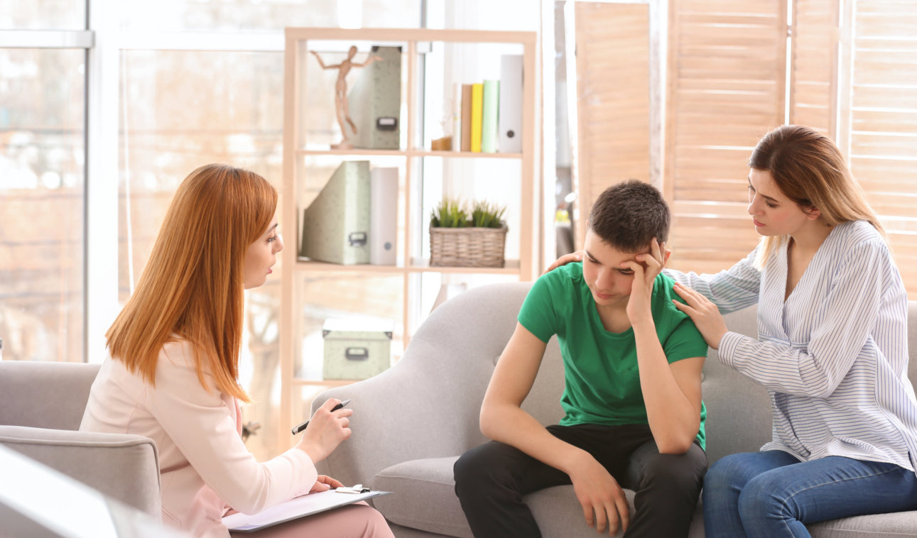 young boy with his mother consulting an mental expert